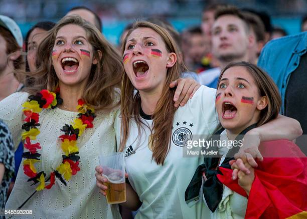 Supporters of the German national soccer team react during the UEFA EURO 2016 match between Germany and France at the public viewing area in the...