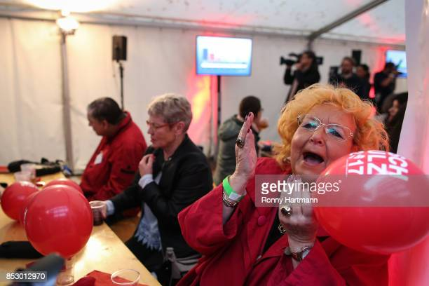 Supporters of the German Social Democrats react to initial results that give the party 202% of the vote giving it a second place finish in German...
