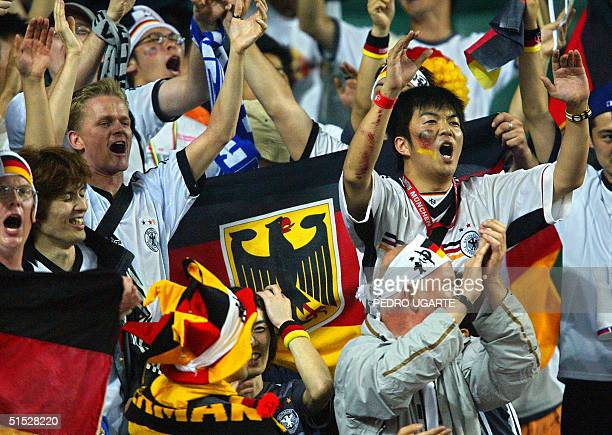Supporters of the German team cheer 11 June 2002 in the bleechers before match 35 group E of the 2002 FIFA World Cup Korea Japan opposing Cameroon...