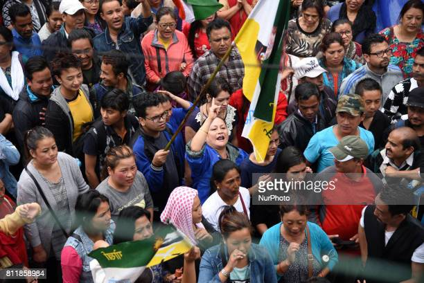 Supporters of the Gorkha Janmukti Morcha called indefinite strike from June 15 and chant slogans as they take part in protest on 9 July 2017 in...