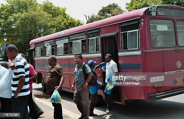 Supporters of the government disembarking from state buses after being transported to the capital for the Sri Lankan government's May Day...