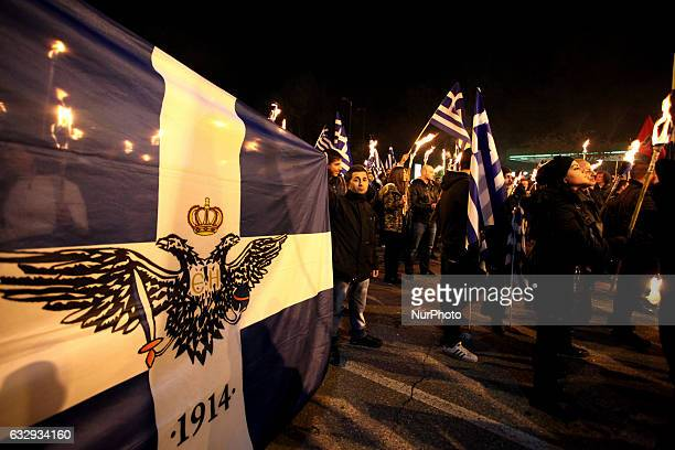 Supporters of the Greek ultra nationalist party Golden Dawn hold Greek flags and torches during a rally in Athens Greece January 28 2017 Supporters...