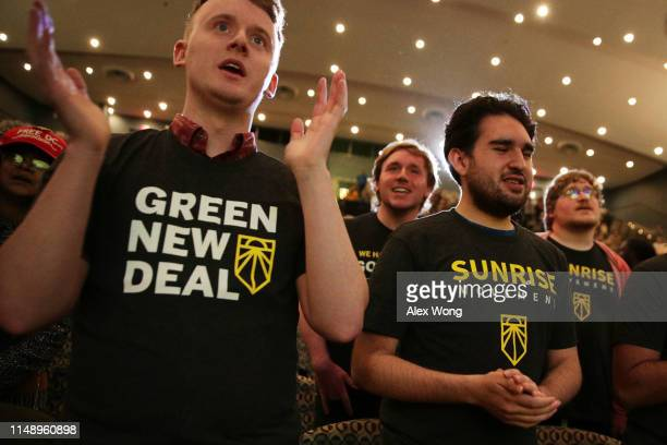 Supporters of the Green New Deal participate in a rally at Howard University May 13 2019 in Washington DC The Sunrise Movement held an event for the...