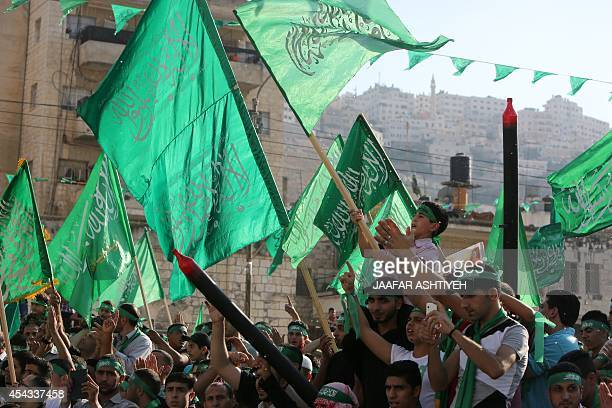 Supporters of the Hamas Islamist movement take part in a rally three days after a deal hailed by Israel and Hamas as 'victory' in the 50day war on...