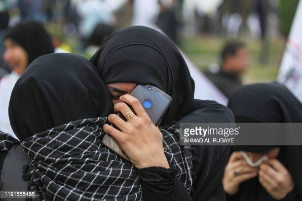Supporters of the Hashed alShaabi paramilitary force and Iraq's Hezbollah brigades attend the funeral of Iranian military commander Qasem Soleimani...
