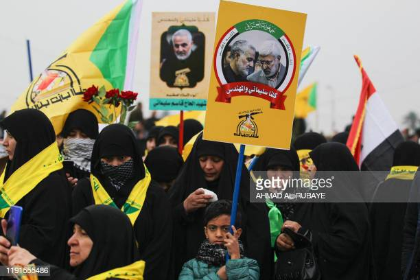 TOPSHOT Supporters of the Hashed alShaabi paramilitary force and Iraq's Hezbollah brigades attend the funeral of Iranian military commander Qasem...