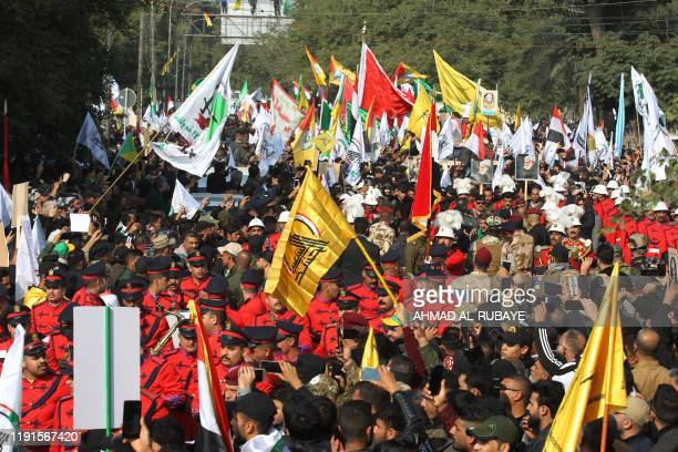 Supporters of the Hashed alShaabi paramilitary force attend the funeral procession of Iraqi paramilitary chief Abu Mahdi alMuhandis Iranian military...