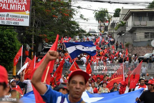Supporters of the Honduran Opposition Alliance Against the Dictatorship and LIBRE party take part in a protest in front of the US embassy in...