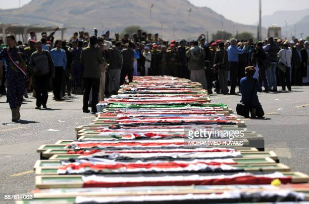 TOPSHOT Supporters of the Huthi movement attend the funeral of those killed during recent clashes between Huthi rebel fighters and loyalists of...
