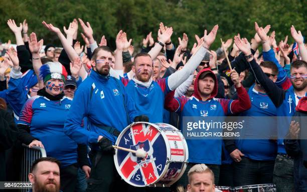 Supporters of the Icelandic national football team react as they watch on a giant screen the Russia 2018 World Cup Group D football match between...