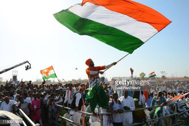 Supporters of the Indian National Congress party react as party president Rahul Gandhi speaks during a rally at Adalaj some 30 kms from Ahmedabad on...