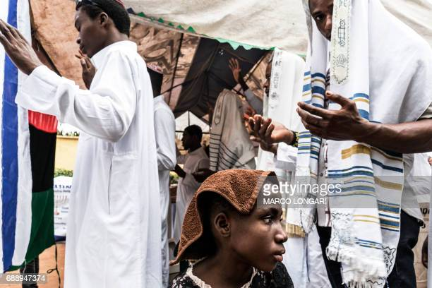 Supporters of the Indigenous People of Biafra members of the Yahveh Yashua Synagogue celebrate Shabbat outside the movement's leader Nnamdi Kanu in...