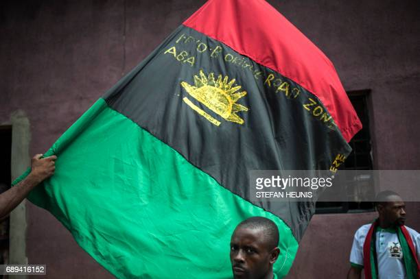 Supporters of the Indigenous People of Biafra wave the Biafra flag on May 28 2017 in the Osusu district of Aba The Nigerian civil wars 50th...