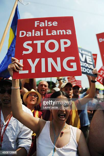 Supporters of the International Shugden Community protest against the Dalai Lama's visit to the Modigliani Forum on June 14 2014 in Livorno Italy The...