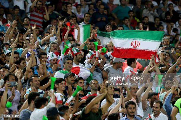 Supporters of the Iranian national football team cheer during the 2018 World Cup qualifying football match between Iran and Uzbekistan at the Azadi...