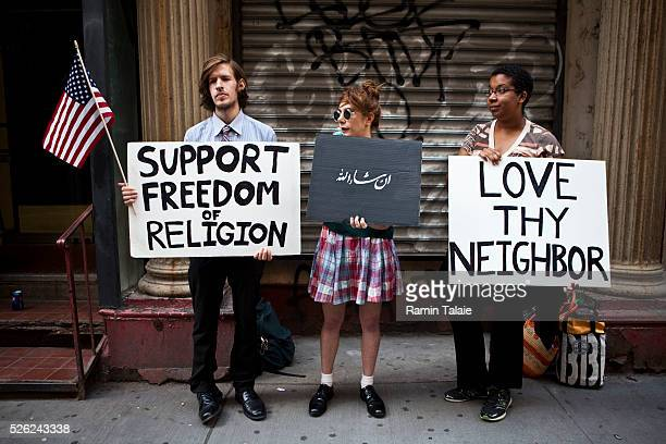 Supporters of the Islamic community center near Ground Zero demonstrate outside of the proposed site on Park Place in Lower Manhattan in New York...