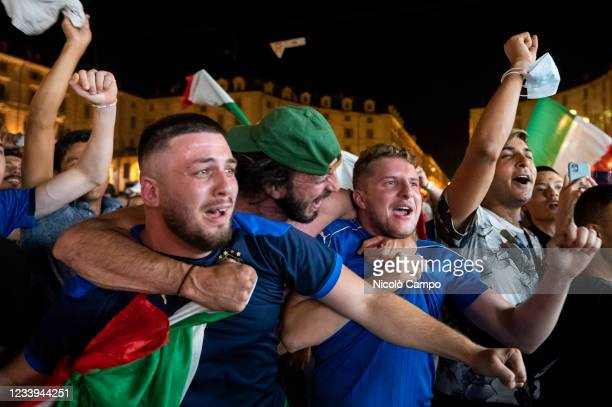 Supporters of the Italian national football team celebrate after Italy beat England 3-2 on penalties to win the UEFA EURO 2020 final football match...
