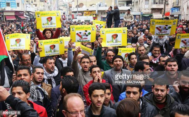 Supporters of the Jordanian Shura Party hold posters reading in Arabic 'Jerusalem is the capital of Palestine' during a demonstration against the US...