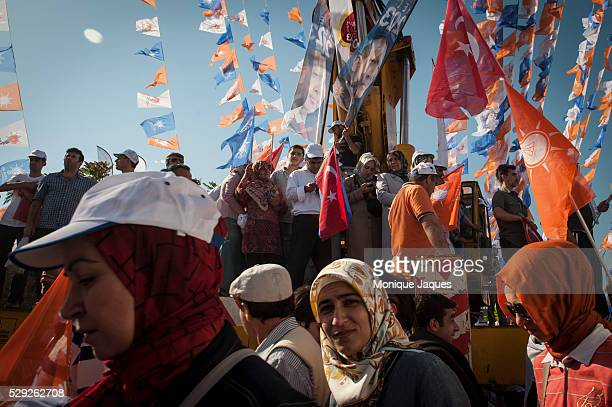 Supporters of the Justice and Development Party in Istanbul Turkey come together to rally for incumbant Prime Minister Recep Tayyip Erdogan in the...