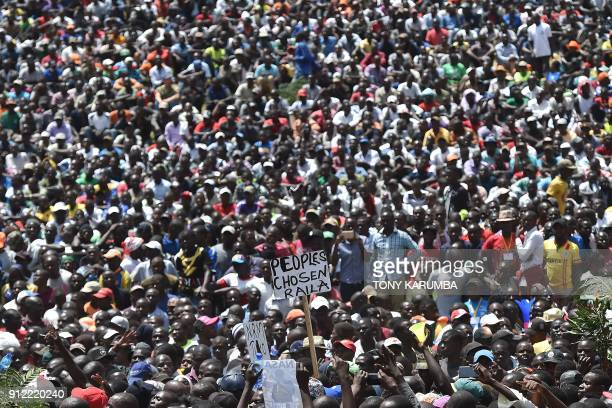 Supporters of the Kenyan opposition National Super Alliance coalition leader gather to watch him have himself sworn in as the 'people's president' on...