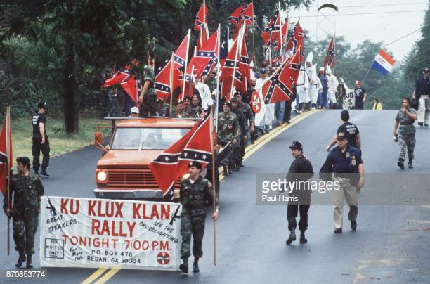 Supporters of the Ku Klux Klan march May 4 Stone Mountain Georgia