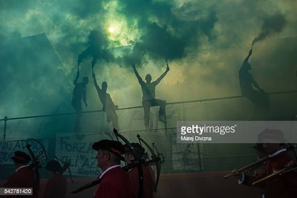 Supporters of the La Santa Croce Azzuri Team cheer on players of their team before the final match of The Calcio Storico Fiorentino between the Santo...