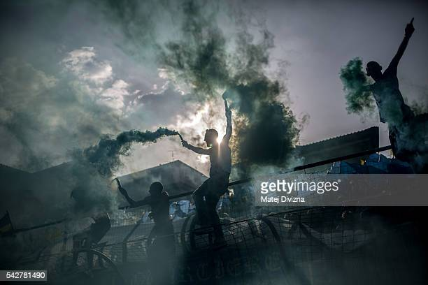 Supporters of the La Santa Croce Azzuri Team cheer on their team before the final match of The Calcio Storico Fiorentino between the Santo Spirito...