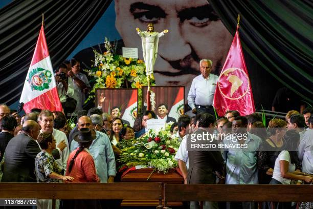 TOPSHOT Supporters of the late Peruvian expresident Alan Garcia pay respects during his wake at the American Popular Revolutionary Alliance party...