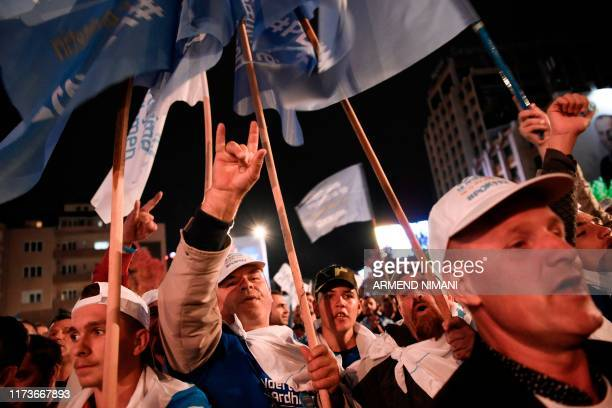 Supporters of the leader of the Democratic Party of Kosovo and parliamentary elections candidate for Prime Minister Kadri Veseli attend a rally in...