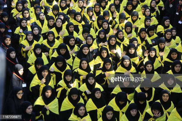 TOPSHOT Supporters of the Lebanese Shiite Hezbollah movement take part in a mourning procession on the tenth day of the lunar month of Muharram which...