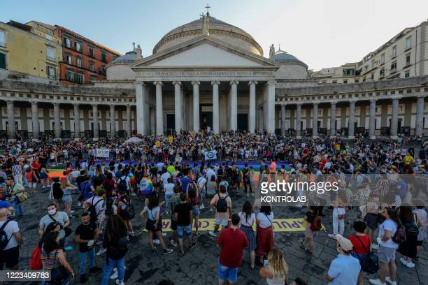Supporters of the lesbian, gay, bisexual and transgender community take part in the flash mob Mediterranean Gay Pride in Plebiscito square, after an...