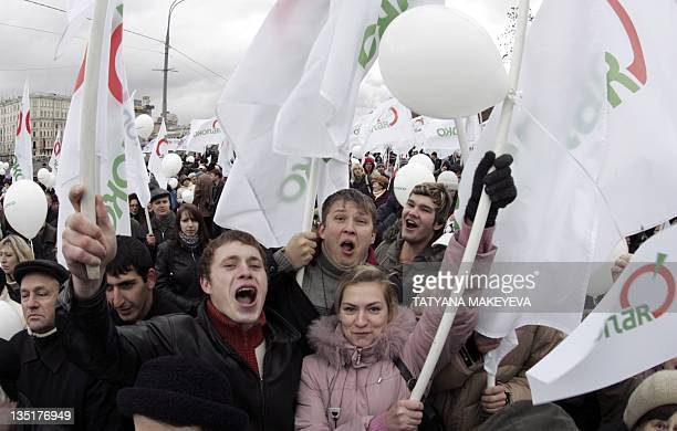 Supporters of the liberal opposition party Yabloko attend a rally marking National Unity Day the new state holiday created by the Kremlin to promote...