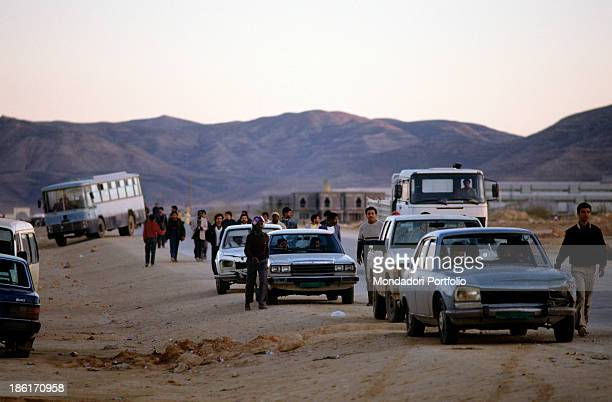 Supporters of the Libyan Colonel Muammar Gaddafi flock in the street on foot and by car during the visit to the Rabta industrial complex to which the...
