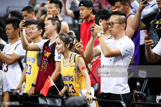 Supporters of the Los Angeles Lakers react during the match against the Brooklyn Nets during a preseason game as part of 2019 NBA Global Games China...