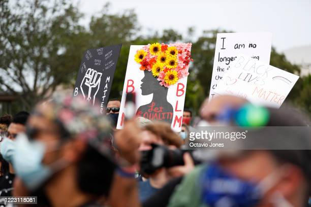 Supporters of the Love Walk listen to WWE wrestler Titus O'Neil speak at Julia B Lane Park on June 27 2020 in downtown Tampa Florida Thaddeus Bullard...