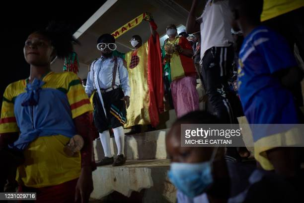 Supporters of the Mali football team watch the projection of the final match of the African Nations Championship between Mali and Morocco in the...
