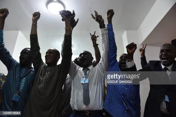 Supporters of the Malian President Ibrahim Boubacar Keita celebrates after the announcement of results of the first round of the presidential...