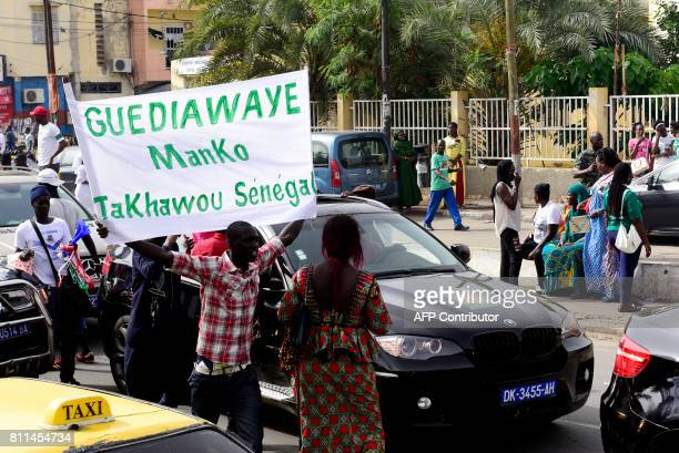 Supporters of the Manko Takhawou Senegal coalition parade in Dakar at the beginning of the campaign for the upcoming legislatie election on July 9...