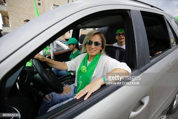 Supporters of the Marada political party parade in their cars in the northern city of Zgharta as they celebrate the parliamentary election results on...