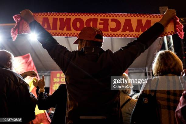 Supporters of the movement to boycott the referendum vote celebrate in the street after election officials announced low voter turn out figures on...