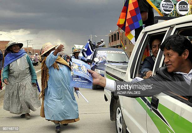 Supporters of the Movement Towards Socialism party take part in a rally supporting their candidate, Evo Morales, ahead of the general elections next...