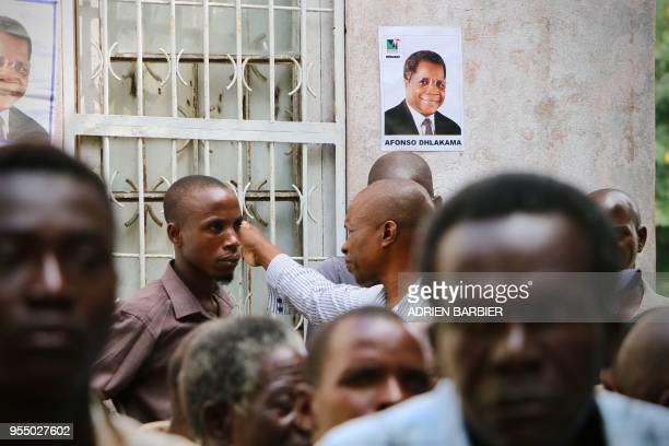 Supporters of the Mozambique's main opposition party RENAMO , take part in a vigil on May 5 following the death of their leader Afonso Dhlakama. -...
