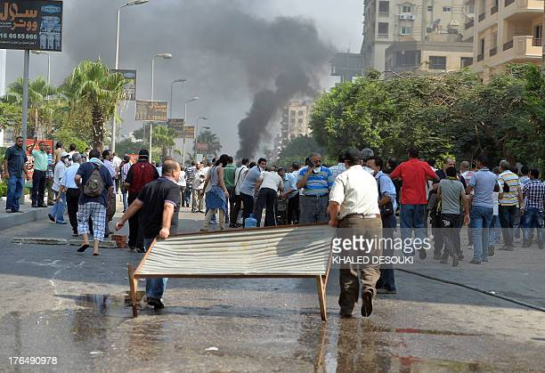 Supporters of the Muslim Brotherhood and Egypt's ousted president Mohamed Morsi try to block a road leading to the Rabaa al-Adawiya protest camp in...