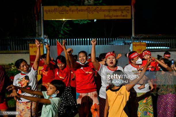Supporters of the National League for Democracy party celebrate in front of the Aung San Suu Kyi's house in Yangon on November 10 as NLD officials...