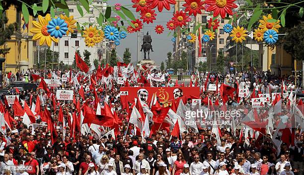 Supporters of the nationalist party Red and Black march on the Tirana's main boulevard during a May Day protest demanding the resignation of Premier...