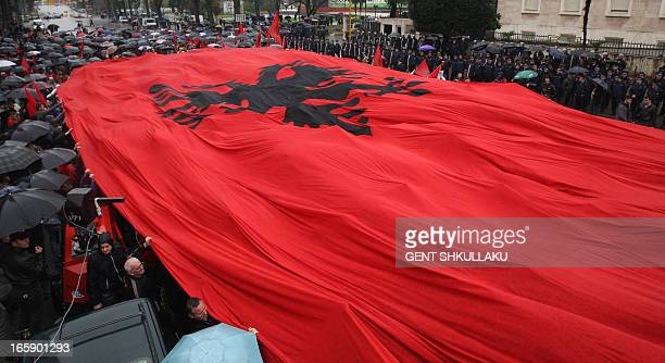 Supporters of the Nationalistic Party Red and Black Alliance open a giant flag during a protest in front of the government headquarters demanding the...