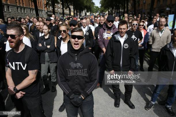 Supporters of the neoNazi Nordic Resistance Movement chant slogans during a demonstration at the Kungsholmstorg square in Stockholm Sweden on August...