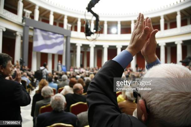 CONTENT] Supporters of the New Democracy applaud Antonis Samaras during his speech April 26 2012