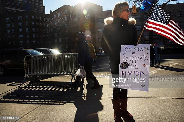 Supporters of the New York Police Department attend a 'Support Your Local Police' news conference and rally at Queens Borough Hall on January 13 2015...