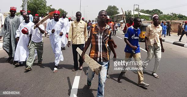 Supporters of the newly appointed emir of Kano hold a demonstration march in his support in the ancient northern Nigerian city of Kano on June 9 2014...
